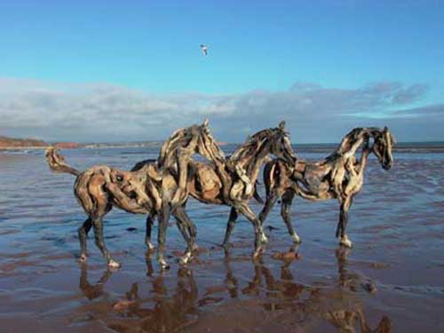 Three horses in the water