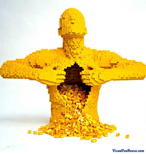 This lego man is opening him self up as his inner lego spills out.
