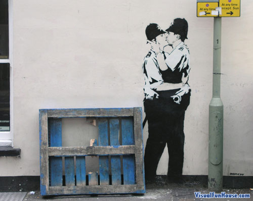 Police Kissing Street Art
