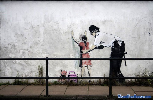 Police pat down little girl street art