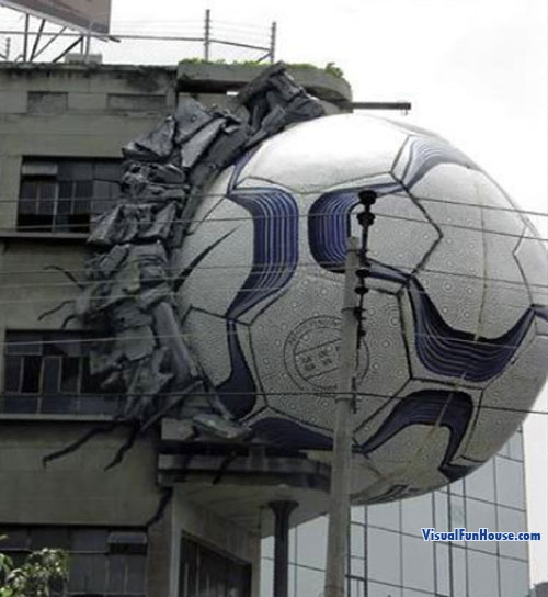 Soccer Ball through Building Ad