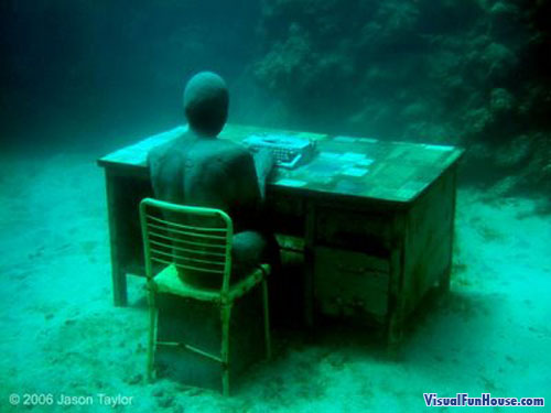 Underwater statue office worker, poor guys is typing at his desk till the bitter end!