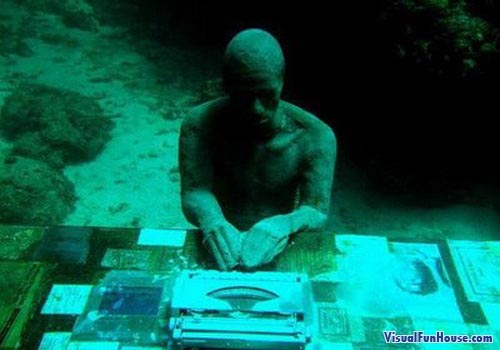 Underwater statue of an office worker at his desk