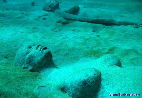 Statue of Women laying on the ocean floor