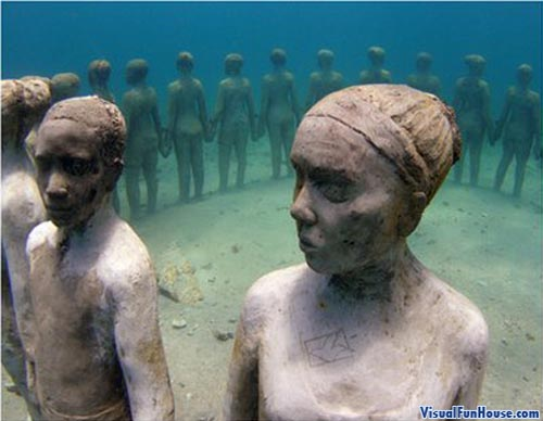 Underwater children statues
