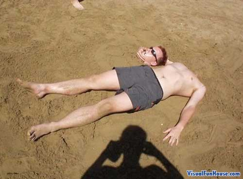 This poor sun tanning guy is headless!