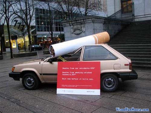 Giant cigarette smashes this poor car sending a powerful message to smokers.