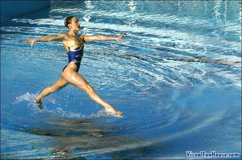 Synchronized swimmer walking across water