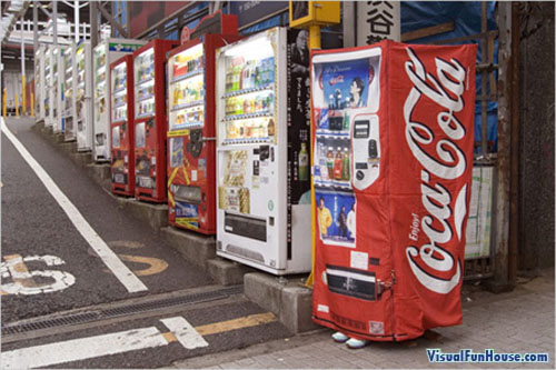 Coca Cola vending machine suit in action