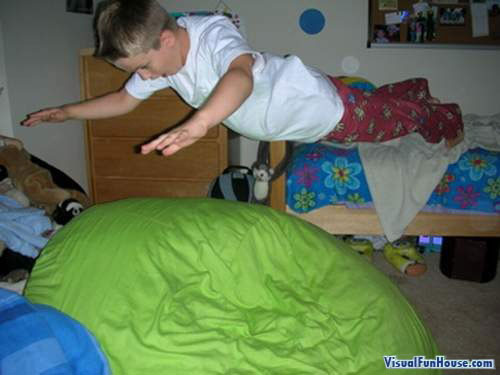 This kid is hovering off his bed!