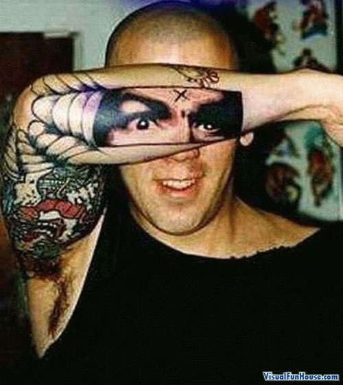 Tattoo of his face on his arm