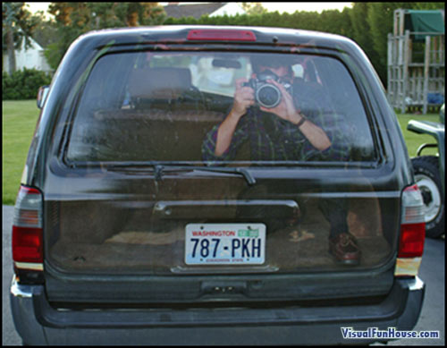 Paparazzi Spying at you through the back of a SUV