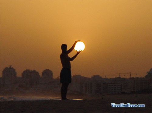 Holding The Sun Optical Illusion
