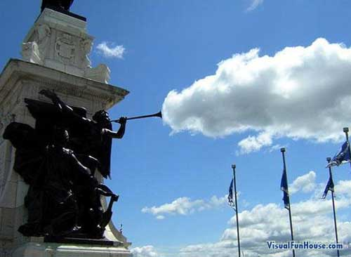 Statue blowing the clouds into the sky