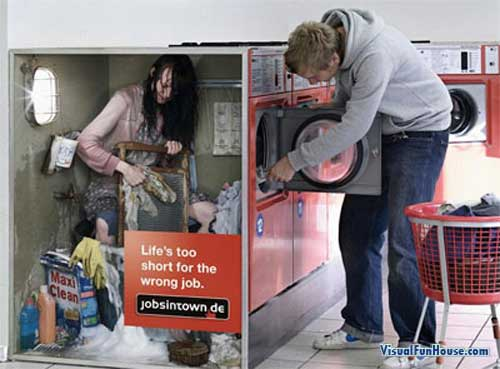 Woman working inside of a washing machine.. and you thought they were all mechanical!
