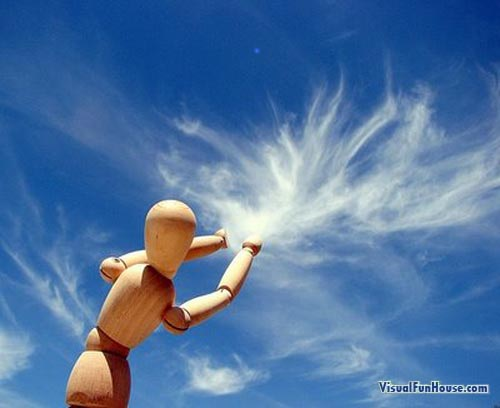 wooden man Grabbing the Clouds