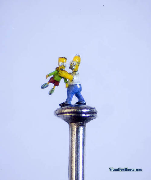 Bart and Homer Simpson on the head of a pin